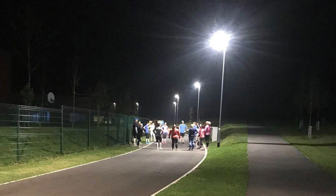 group running at night outdoors